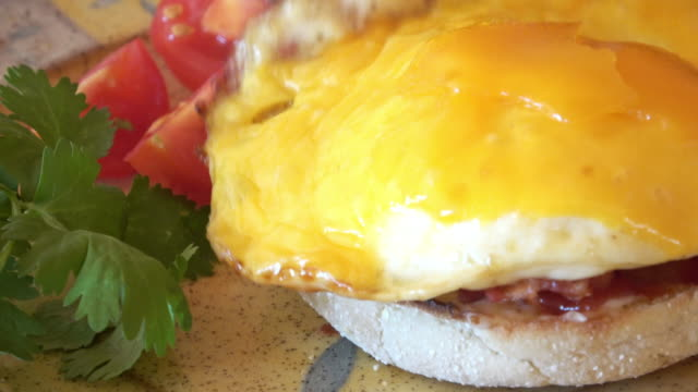 egg muffin breakfast sandwich - bacon stock videos & royalty-free footage