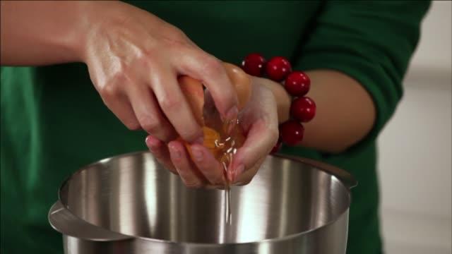 egg - separating yolk from egg white - egg yolk stock videos & royalty-free footage