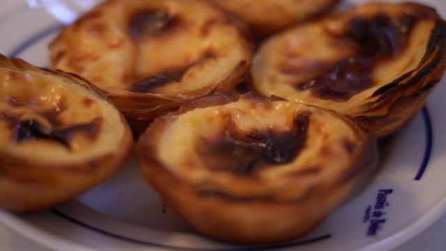 egg tart of pasteis de belem / portugal - small group of objects stock videos & royalty-free footage