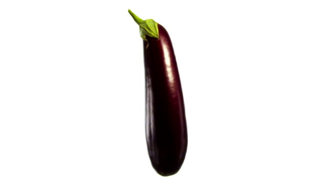 eggplant spinning and rotating isolated on white background food suspended in the air - aubergine stock videos & royalty-free footage