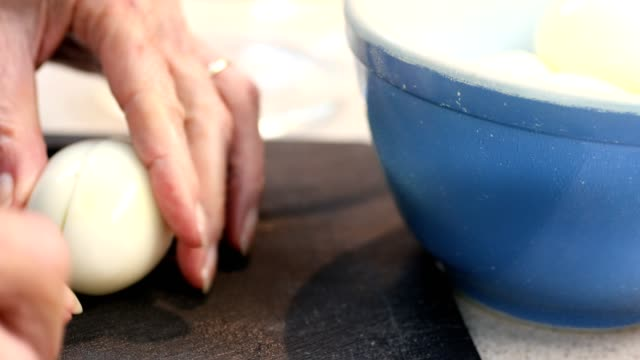 Eggs being prepared in the kitchen for salad