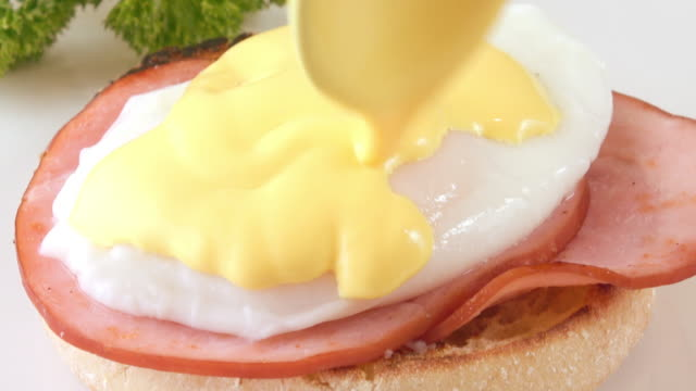 eggs benedict - hollandaise sauce stock videos and b-roll footage