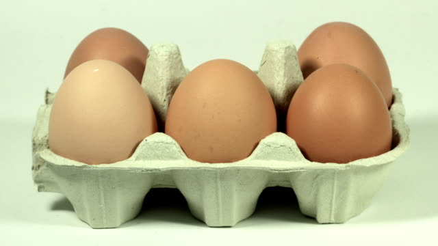 eggs in carton, hd - egg stock videos & royalty-free footage