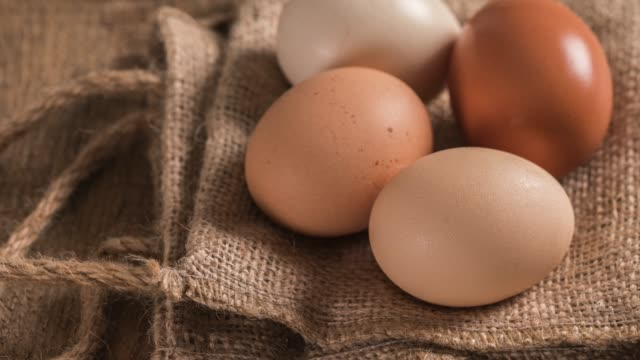 eggs on rustic wooden table - rustic stock videos & royalty-free footage