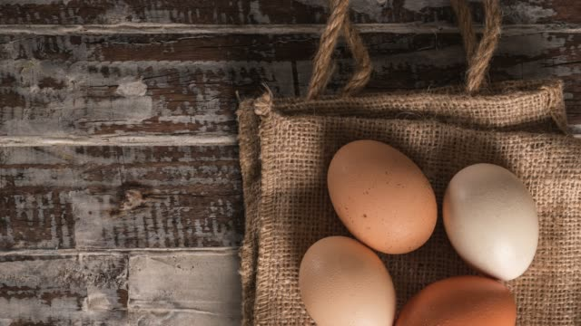 Eggs on rustic wooden table