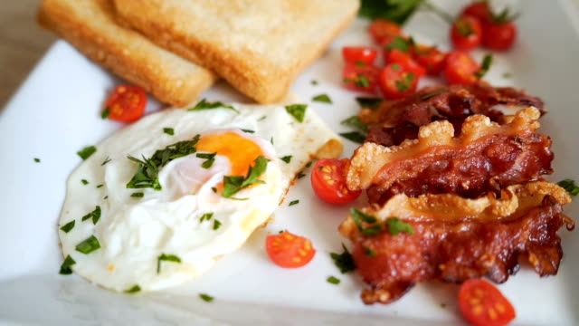 Eggs, toast and bacon for breakfast