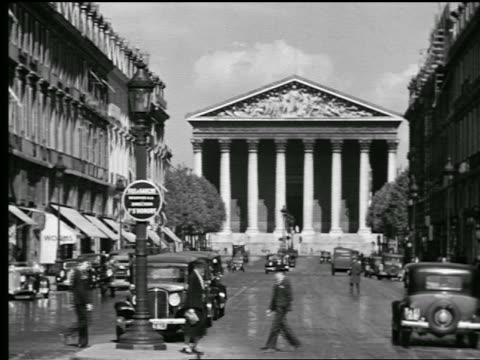 B/W 1927 Eglise de la Madeleine at end of Rue Royale with traffic + people in foreground / Paris, France