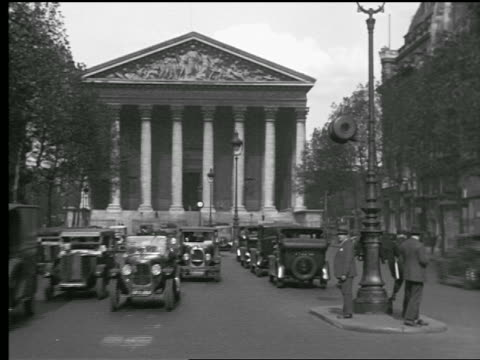 B/W 1927 Eglise de la Madeleine + Rue Royale with traffic + people in foreground / Paris, France
