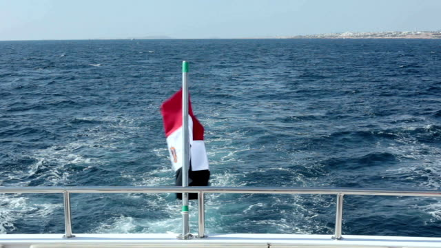 egypt flag at the stern of the yacht. - red sea stock videos & royalty-free footage