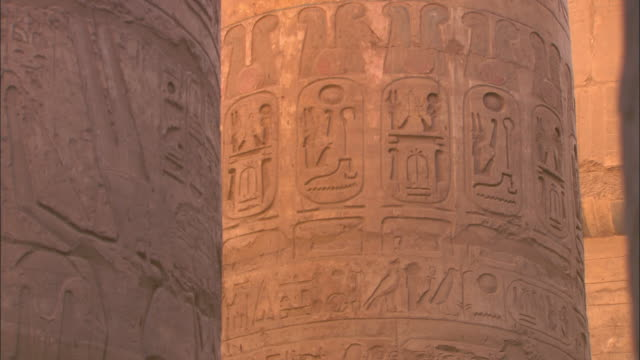 Egyptian carvings and hieroglyphics decorate the pillars of Karnak Temple.