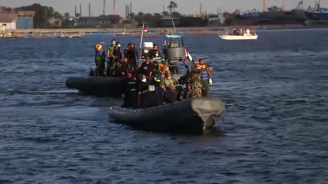 egyptian coast guard and rescue workers bring ashore bodies recovered from a capsized refugee boat in the port city of rosetta egypt on september 27... - capsizing stock videos & royalty-free footage