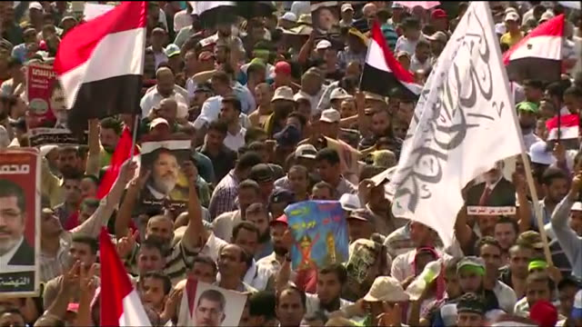 egyptian demonstrators rally in support of the deposed president mohamed morsi after the 2013 egyptian military coup - (war or terrorism or election or government or illness or news event or speech or politics or politician or conflict or military or extreme weather or business or economy) and not usa stock videos & royalty-free footage