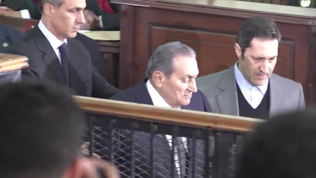 egyptian deposed president hosni mubarak appears in an egyptian courtroom in cairo as a witness against the ousted president mohamed morsi - court stock videos & royalty-free footage