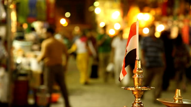 stockvideo's en b-roll-footage met egyptian flag in a candlestick at a night market/ cairo/ egypt - caïro
