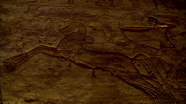 Egyptian hieroglyphs mark the stone walls of the temple of Hathor and Nefertari. Available in HD.