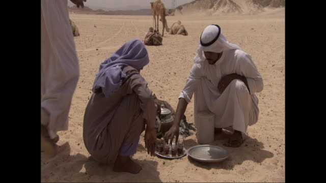 egyptian men prepare beverages on a serving tray in the desert. - serving tray stock videos and b-roll footage