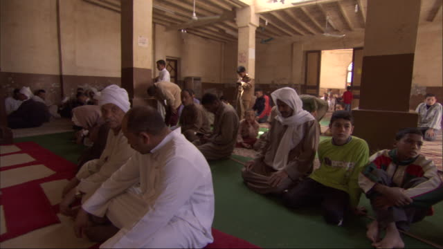 egyptian muslims sit together in a room to pray. - religion stock videos & royalty-free footage