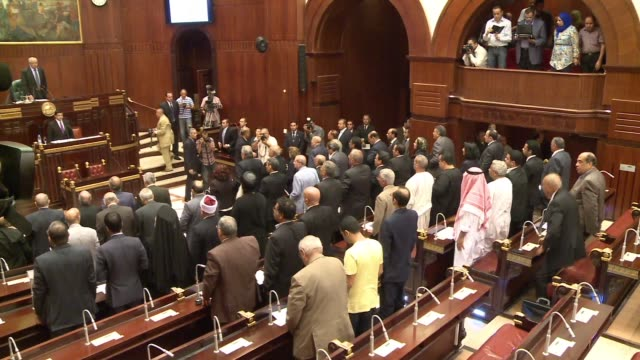 egyptian parliamentarians rise to begin meeting view of egyptian seal - parliament building stock videos & royalty-free footage