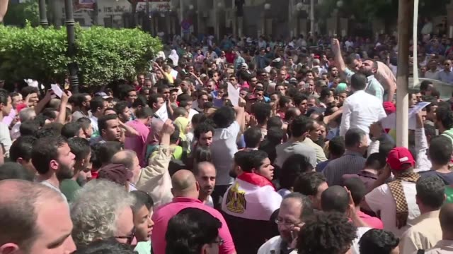 Egyptian police fire tear gas at dozens of protesters in Cairo who rallied against a controversial deal to hand two islands in the Red Sea to Saudi...