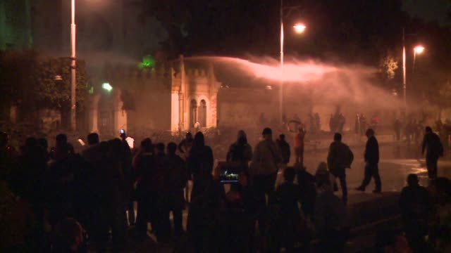 egyptian police fired tear gas and water cannon at stone throwing protesters outside the presidential palace on monday as the opposition held rallies... - cairo stock videos & royalty-free footage