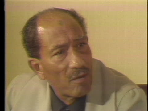 egyptian president anwar sadat talks to a reporter about the nobel peace prize in 1978, saying that if the parties stick to the spirit of the camp... - 1978 stock videos & royalty-free footage