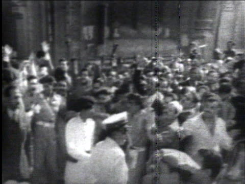egyptian president gamal nasser waves at an enthusiastic crowd in cairo as he leaves a mosque. - thanksgiving politics stock videos & royalty-free footage
