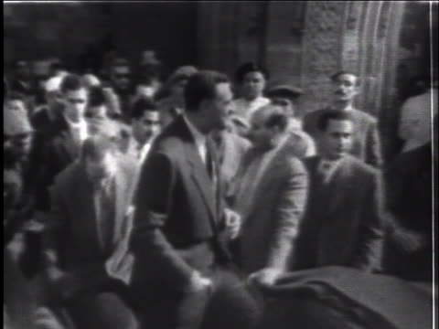 egyptian president gamal nasser waves at an enthusiastic crowd in cairo, egypt, as he leaves a mosque during the suez crisis - (war or terrorism or election or government or illness or news event or speech or politics or politician or conflict or military or extreme weather or business or economy) and not usa stock videos & royalty-free footage