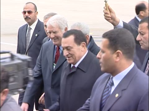 egyptian president hosni mubarak arrives at heathrow for start of london visit walks across tarmac in vip area under an umbrella - president of egypt stock videos & royalty-free footage