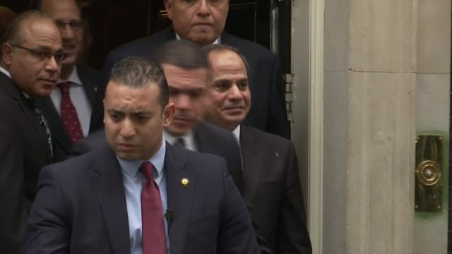 egyptian president leaves downing street england london downing street ext turkish government officials and security exit 10 downing street / abdel... - president of egypt stock videos & royalty-free footage