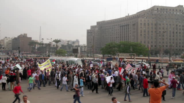 egyptian protestors march down a street. - egypt stock videos & royalty-free footage