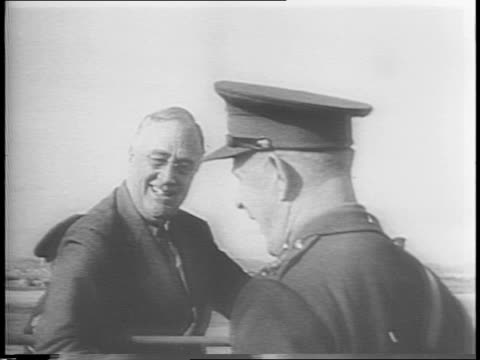 egyptian pyramids / map of europe / uniformed servicemen lord gort and a clergyman greet president franklin d roosevelt on a tarmac / president... - ヒーロー点の映像素材/bロール