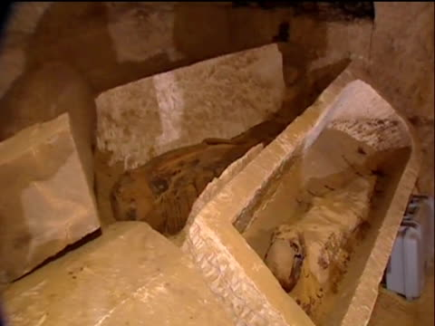egyptian remains found in limestone sarcophagi from excavated pharaonic tomb 11 february 2009 - digging stock videos & royalty-free footage