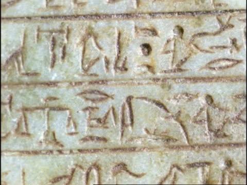 egyptian scarab beetle prayer stone, cu part of stone, hieroglyphics, england - geroglifico video stock e b–roll