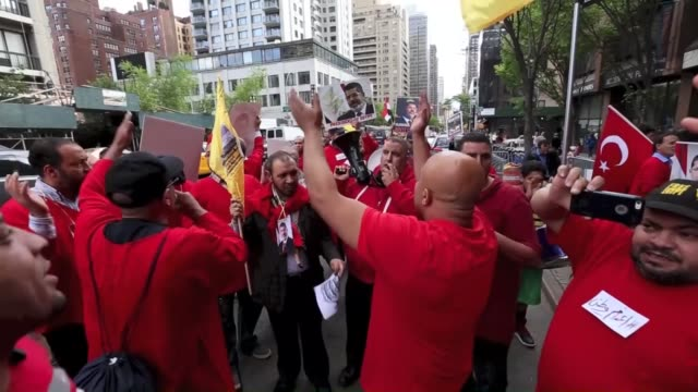 egyptians in new york hold a rally in front of egypt's consulate general to protest recent death sentences handed down to the country's only... - sentencing stock videos & royalty-free footage