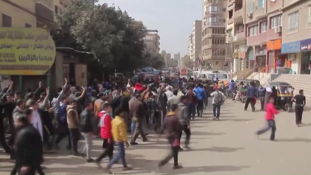 egyptians march and shout slogans in the badrashin neighborhood of giza, egypt during a demonstration on the 4th anniversary of egyptian revolution... - revolution stock videos & royalty-free footage