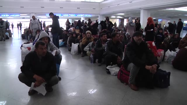 egyptians wait at djerba airport in tunisia on february 20, 2015 for arriving egypt due to security issues after islamic state of iraq and levant... - isis beheading stock-videos und b-roll-filmmaterial