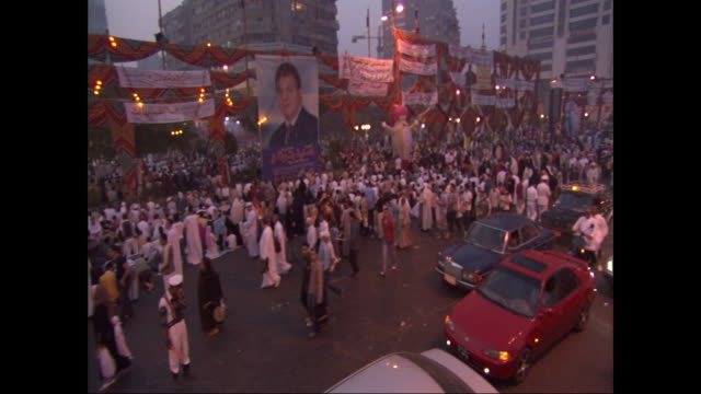 egyptians wave at the camera during a festival parade. - middle eastern ethnicity stock videos & royalty-free footage