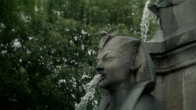 egyptian-style fountain, paris, france - fountain stock videos & royalty-free footage