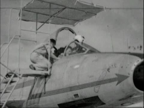 egypt/israel war starts; gaza strip bv scramble ground crew take sign away pilot into cockpit plane taxis l-r two planes take off r-l pos 16mm... - palestinian territories stock videos & royalty-free footage