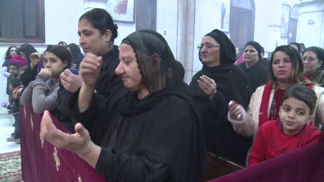 egypts christians rang in the new year wednesday with prayers for peace after months of unrest and several deadly attacks on churches but expressed... - religiöse stätte stock-videos und b-roll-filmmaterial