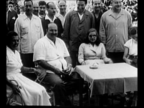 egypt's former king farouk i walks with family members and entourage during his exile in europe / farouk former queen narriman and family sit near... - card table stock videos & royalty-free footage