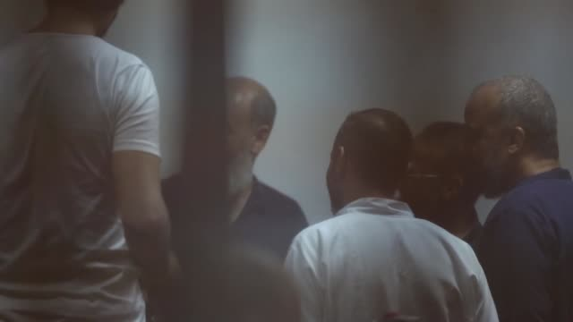 egypt's former president mohamed morsi and other defendants sit inside the defendants' cage in a courtroom at the police academy during their trial... - 2017 stock videos & royalty-free footage