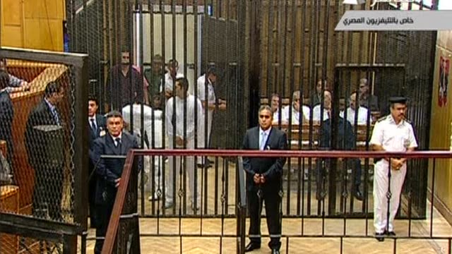 egypt's ousted president hosni mubarak appears on a stretcher for the opening of his murder trial in cairo as his two sons stand by his side in the... - legal trial stock videos & royalty-free footage