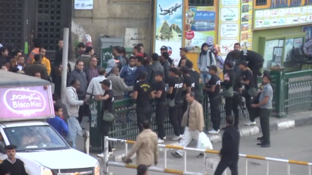 egypt's police forces tight security measures at tahrir square in cairo on november 30 2014 after hundreds of egyptian people protest the court... - president of egypt stock videos & royalty-free footage