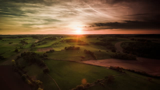 aerial: eifel mountain range in germany at sunset - hill stock videos & royalty-free footage