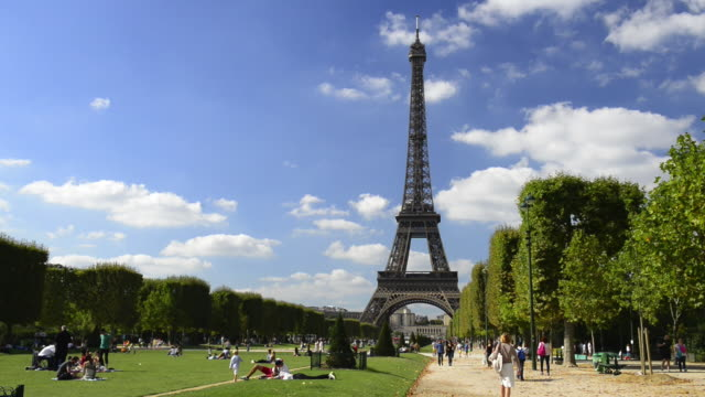 eiffel tower and champ de mars - eiffel tower paris stock videos & royalty-free footage