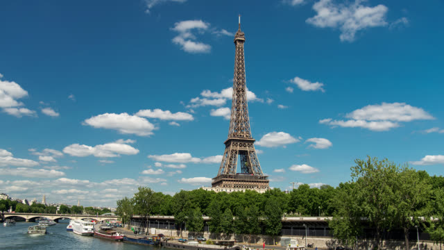 T/L WS Eiffel Tower and River Seine in Paris, France with clouds