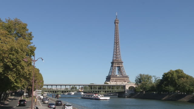 eiffel tower and river seine paris - eiffel tower stock videos & royalty-free footage