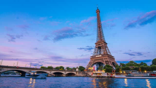 eiffel tower as seen from across seine river - eiffel tower paris stock videos & royalty-free footage