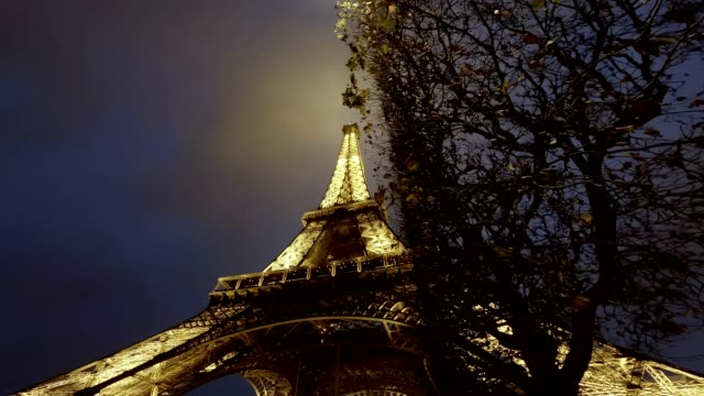 eiffel tower at night in paris france - french culture stock videos & royalty-free footage